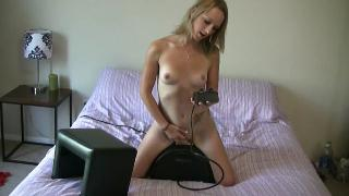 Petite blonde fucks herself with a sex machine in bed