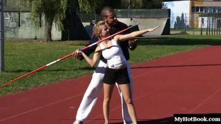 This buxom blonde college coed has been taking javelin lessons from her muscular